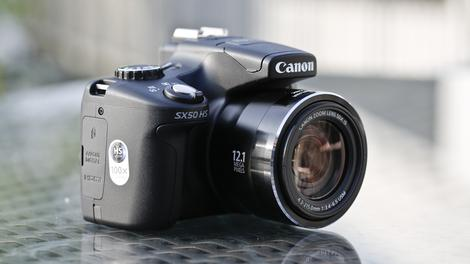 features distinguish the 12.1MP Canon SX50 HS from the 12.1MP Canon